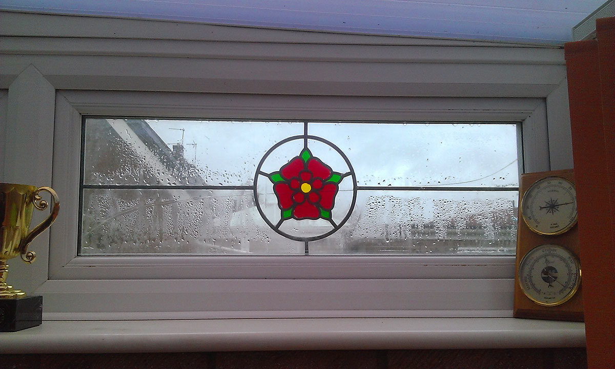 S&C Window repairs stained glass windows in Norfolk